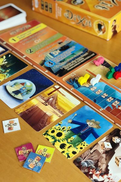 Game Reviews: DiXit - This uniquegame is easy to learn, perfect for multi-generational game nights and inspires the imagination. #boardgames #familygames #dixit #gamenight *Loving this family's website and game suggestions